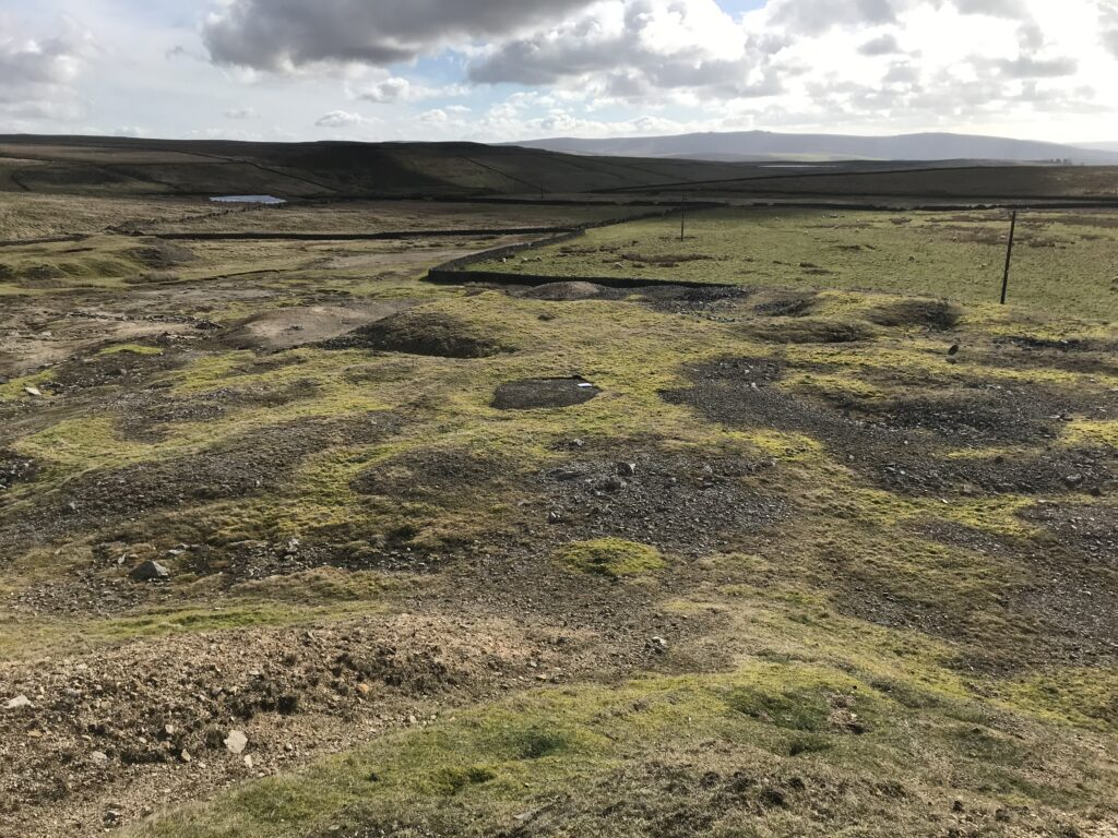 A view from atop the spoil heap down towards Bowdin's gin shaft (now capped).