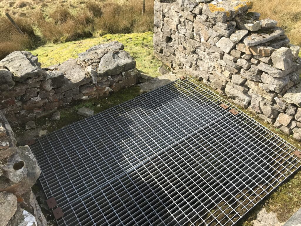 Another image of the grating around the manway shaft