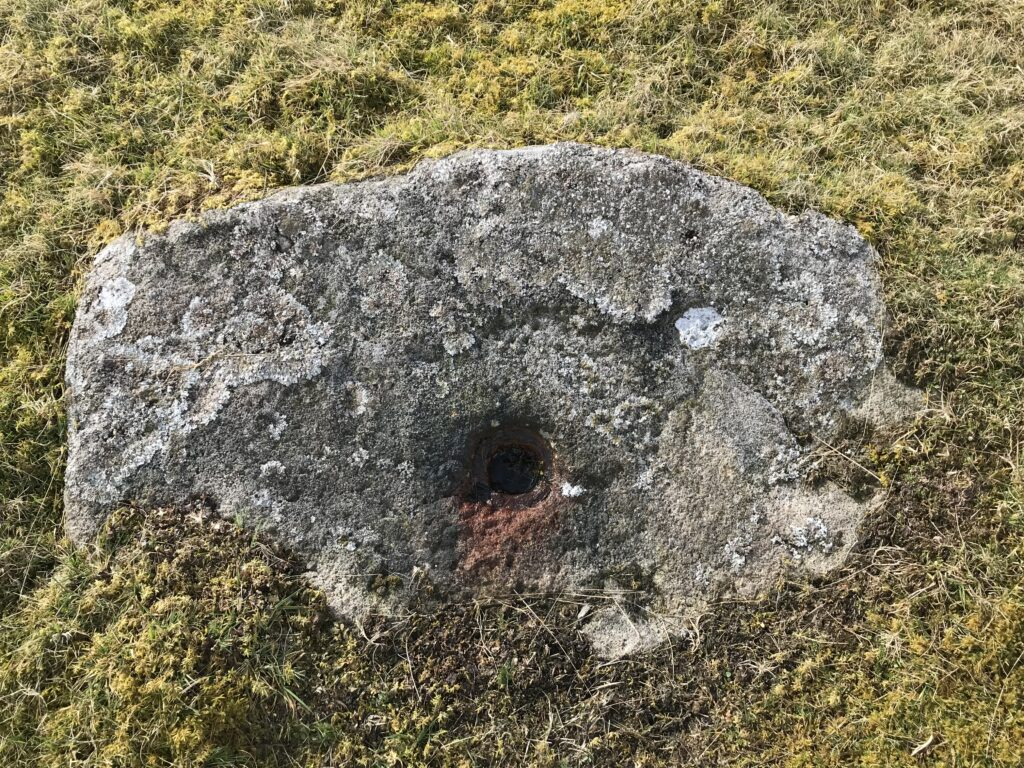 A large stone block in the centre of the horse whim. The whole in the centre was used for the winding wheel